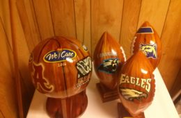 Wooden footballs and basketball made by an Alabama inmate